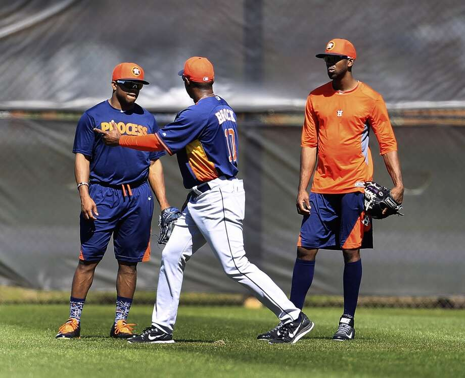 Astros first base coach Tarrik Brock (10) does one-on-one drills with Delino DeShields, left, and Dexter Fowler, right, during workouts for early-arriving position players. Photo: Karen Warren, Houston Chronicle