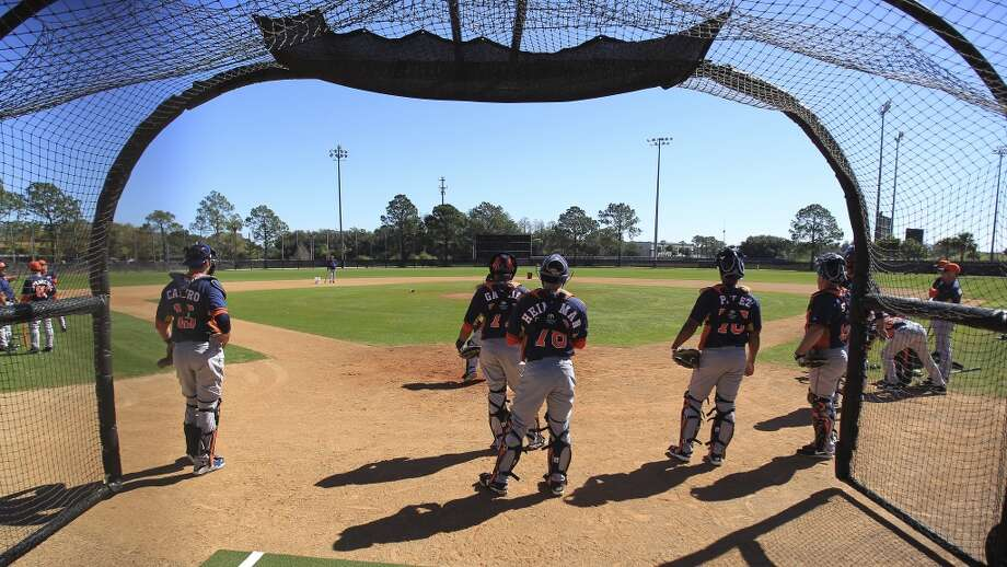 Astros catchers gather during a workout. Photo: Karen Warren, Houston Chronicle