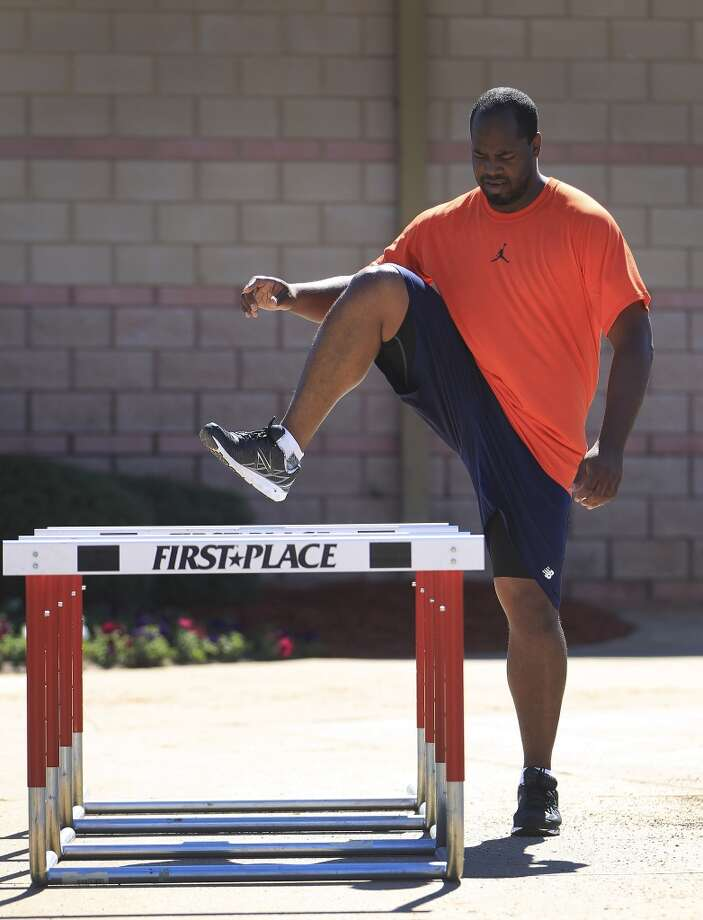 Jerome Williams does some hip and leg work with hurdles after the regular pitcher and catcher workouts on Tuesday. Photo: Karen Warren, Houston Chronicle