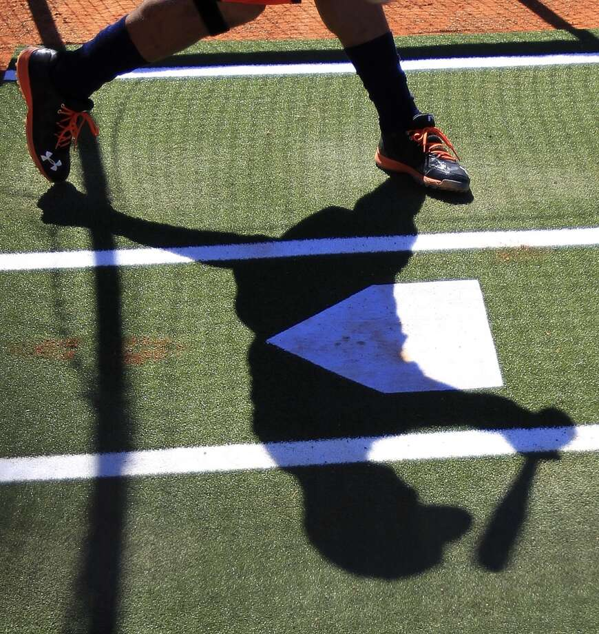 An Astros player casts a shadow in the batting cages. Photo: Karen Warren, Houston Chronicle