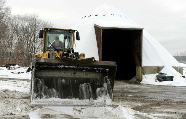 A public works employee uses a bucket loader to clear snow from the grounds at the Public Works Dept. in Shelton, Conn. Tuesday, Feb. 15, 2014. Photo: Autumn Driscoll / Connecticut Post