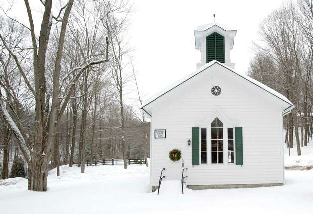 The Plumtrees School on the corner of Plumtrees Road and Taylor Road in Bethel, Conn, sits covered in snow on Tuesday, February 18, 2014. According to the Plumtrees School Association website it was the last operating one room school house in America. Photo: H John Voorhees III / The News-Times Freelance