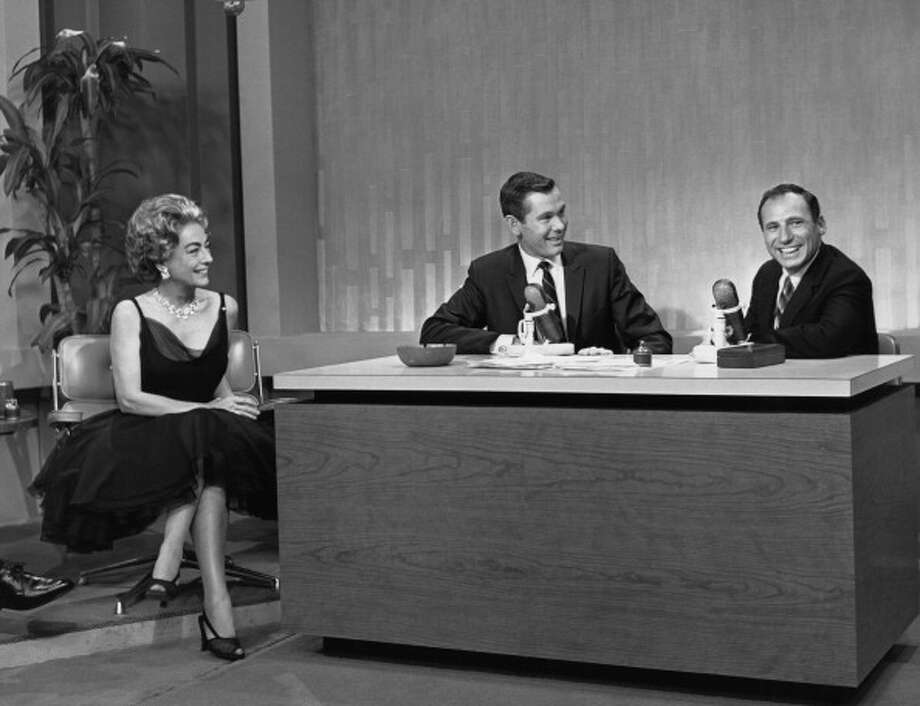 Joan Crawford and Mel Brooks visit with host Johnny Carson on Oct. 1, 1962. Photo: NBC, NBC Via Getty Images / 2012 NBCUniversal, Inc.