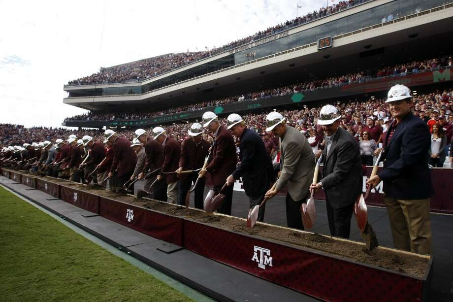 Texas A&M officials ceremoniously break ground on the renovation of Kyle Field on Nov. 9, 2013. Moments after the Aggies' 51-41 victory over Mississippi State, the renovation began. Photo: Cody Duty, Houston Chronicle