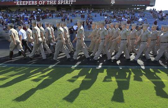A&M Corps of Cadets march around the track before the start of a game on Sept. 21, 2013. Photo: Karen Warren, Houston Chronicle