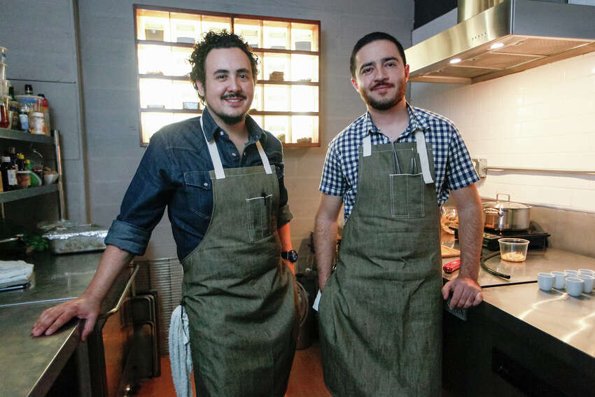 Chefs Rico Torres (left) and Diego Galicia in the kitchen at Mixtli restaurant, 5251 McCullough, on Wednesday, Feb. 12, 2014. MARVIN PFEIFFER/ mpfeiffer@express-news.net