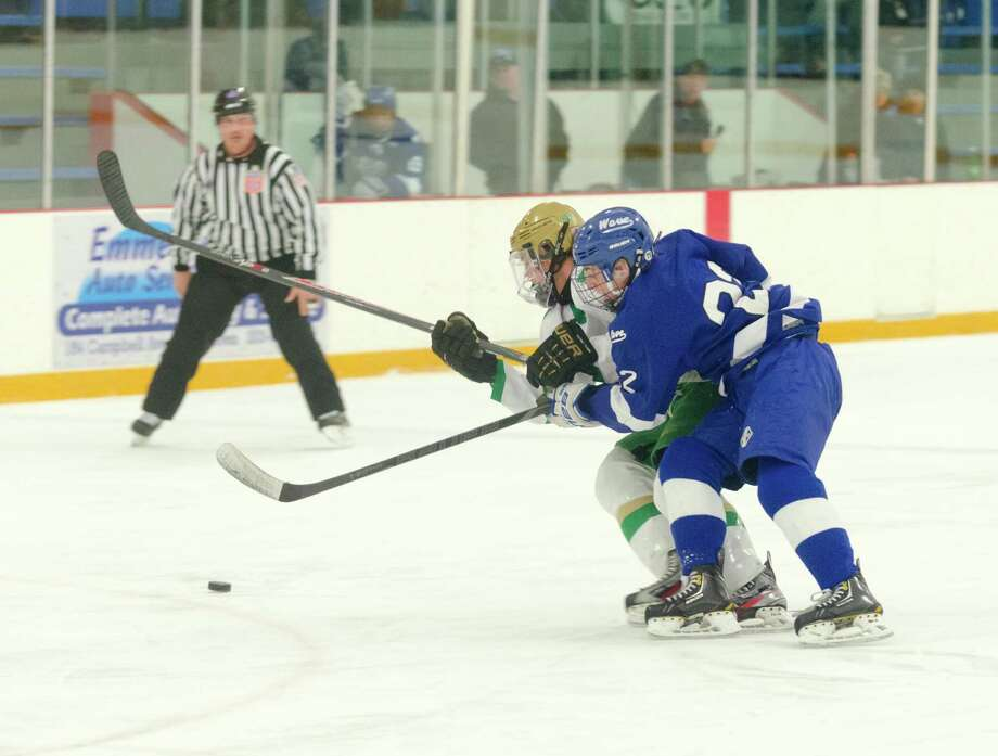 Notre Dame West Haven's Alex Andreucci (11) and Darien's Jack Pardue (22) battle for control of the puck during the boys ice hockey game at Bennett Skating Rink in West Haven on Monday, Feb. 17, 2014. Photo: Amy Mortensen / Connecticut Post Freelance