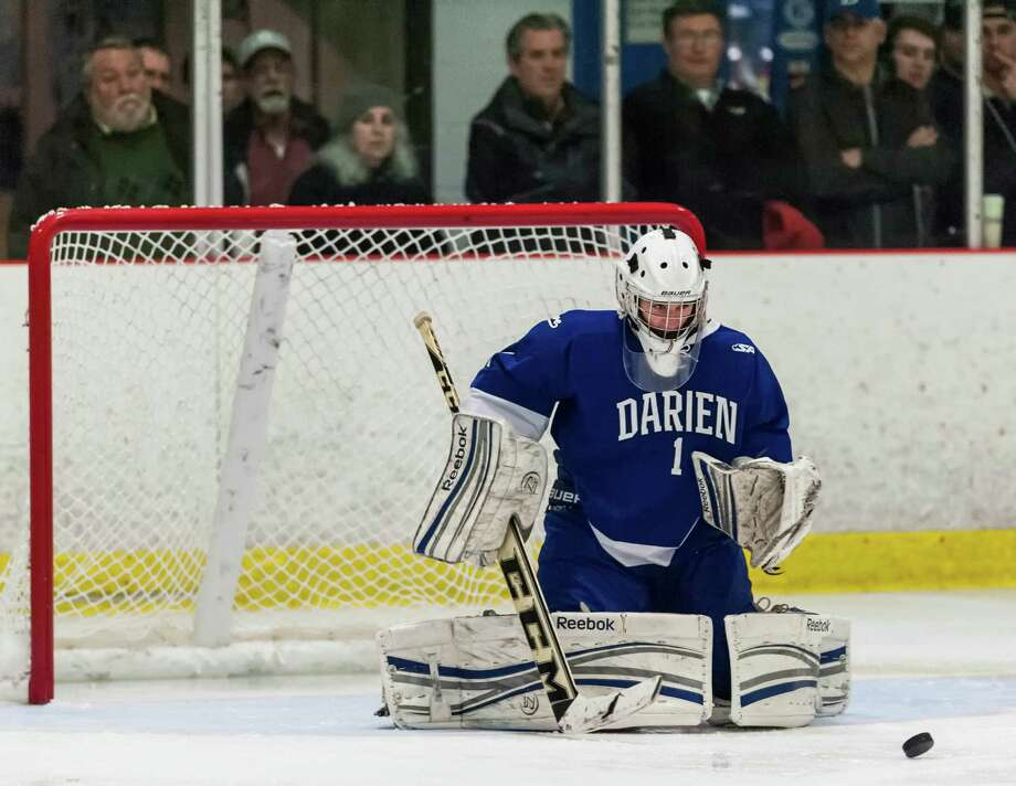 Darien high school goalie Michael Colon watches as the puck goes by the front of his goal during a boys ice hockey game against New Canaan high school played at Darien Ice Rink, Darien CT on Saturday, January, 11th, 2014. Photo: Mark Conrad / Connecticut Post Freelance