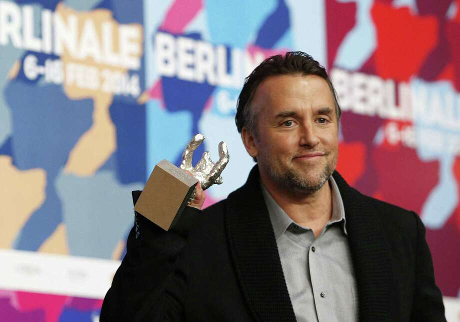 "Richard Linklater holds his Silver Bear award for best director for ""Boyhood"" at the 64th Berlinale Film Festival in Berlin. Photo: Getty Images / AFP"