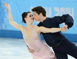 Tessa Virtue and Scott Moir of Canada perform their free dance during the ice dancing competition at the Iceberg Skating Palace during the Winter Olympics in Sochi, Russia, Monday, Feb. 17, 2014. Virtue and Moir won the silver medal in the event. (Chuck Myers/MCT)