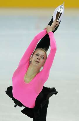 Polina Edmunds of the United States skates during a practice session at the figure stating practice rink at the 2014 Winter Olympics, Monday, Feb. 17, 2014, in Sochi, Russia. (AP Photo/Darron Cummings)