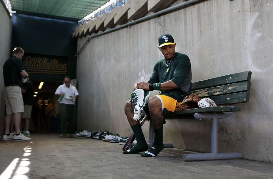 A's infielder Addison Russell, (17) finishes up batting practice and prepares to head to the clubhouse at Phoenix Municipal Stadium in Phoenix, Arizona on Tuesday Feb. 18,  2014. Major League Baseball's  Oakland Athletics continue their spring training in the Arizona Desert  to prepare for the upcoming season. Photo: The Chronicle