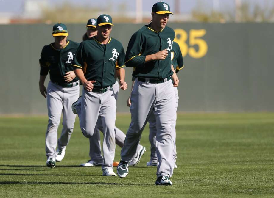 A's pitchers Jim Johnson, (45) (right) and Luke Gregerson, (44) just behind Gregerson, during warm up drills at the Papago Baseball Facility in Phoenix, Arizona on Tuesday Feb. 18,  2014. Major League Baseball's Oakland Athletics continue their spring training in the Arizona Desert in preparation for the upcoming season. Photo: The Chronicle