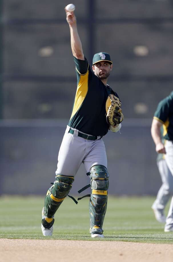 A's catcher Dusty Brown, (74) during practice drills at the Papago Baseball Facility in Phoenix, Arizona on Tuesday Feb. 18, 2014. Major League Baseball's Oakland Athletics continue their spring training in the Arizona Desert in preparation for the upcoming season. Photo: The Chronicle