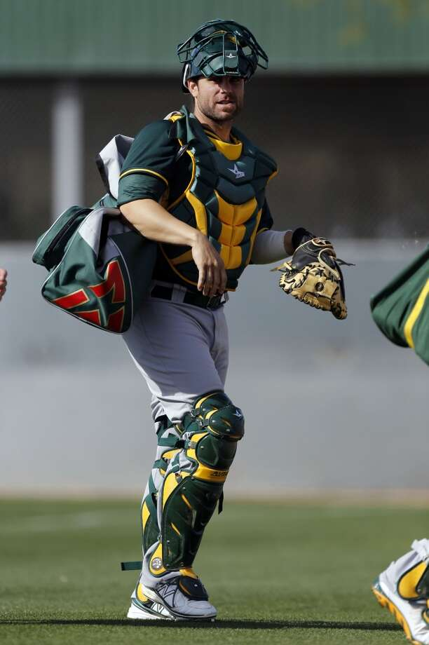 A's catcher Dusty Brown, (74) heads off to practice at the Papago Baseball Facility in Phoenix, Arizona on Tuesday Feb. 18,  2014. Major League Baseball's Oakland Athletics continue their spring training in the Arizona Desert in preparation for the upcoming season. Photo: The Chronicle
