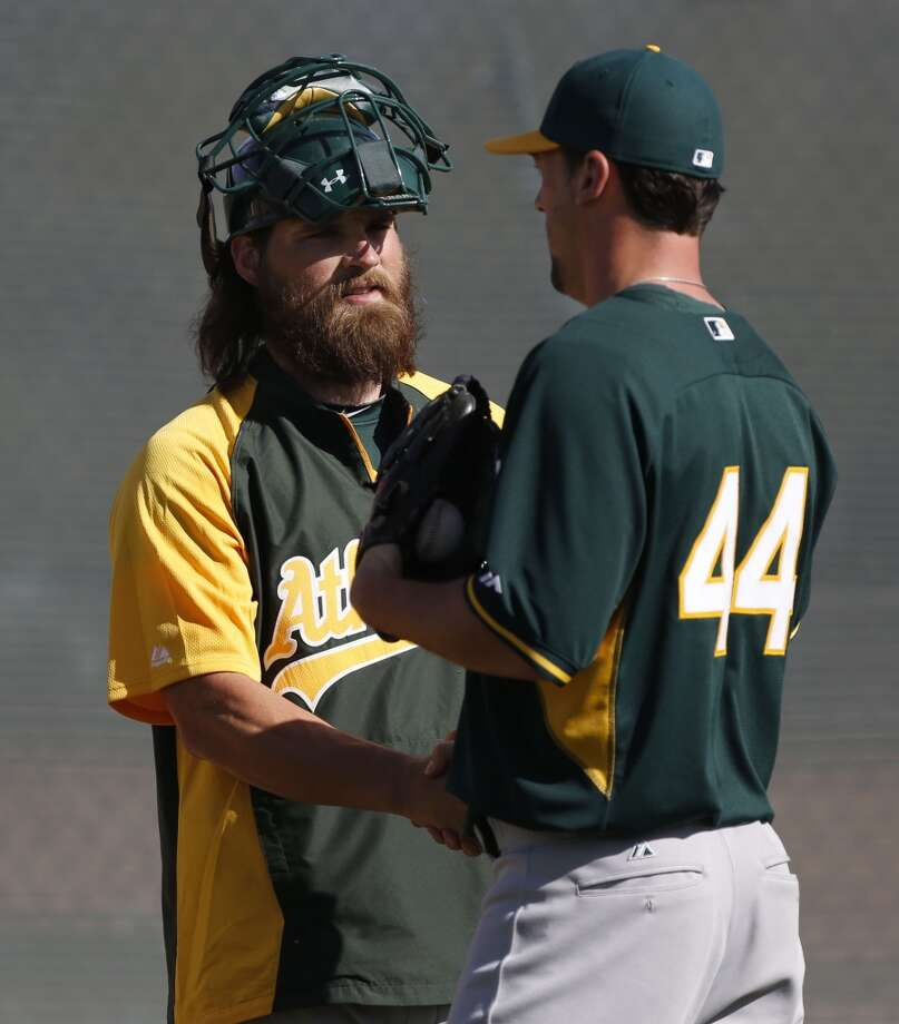 A's catcher Derek Norris, (36 left) greets pitcher Luke Gregerson, (44)  during practice drills at the Papago Baseball Facility in Phoenix, Arizona on Tuesday Feb. 18,  2014. Major League Baseball's Oakland Athletics continue their spring training in the Arizona Desert in preparation for the upcoming season. Photo: The Chronicle
