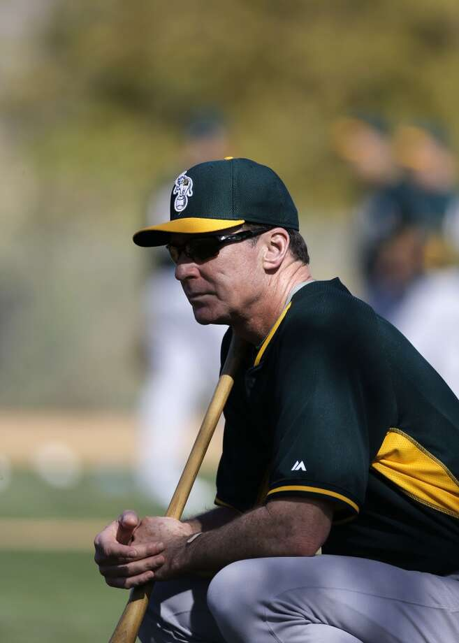 A's manager Bob Melvin keeps a close watch on practice at the Papago Baseball Facility in Phoenix, Arizona on Tuesday Feb. 18,  2014. Major League Baseball's Oakland Athletics continue their spring training in the Arizona Desert in preparation for the upcoming season. Photo: The Chronicle