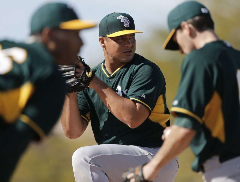 A's pitcher Jose Flores, (72) throws during practice at the Papago Baseball Facility in Phoenix, Arizona on Tuesday Feb. 18,  2014. Major League Baseball's Oakland Athletics continue their spring training in the Arizona Desert in preparation for the upcoming season. Photo: The Chronicle