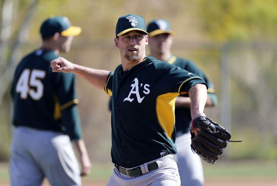 A's pitcher Luke Gregerson, (44) during practice drills at the Papago Baseball Facility in Phoenix, Arizona on Tuesday Feb. 18,  2014. Major League Baseball's Oakland Athletics continue their spring training in the Arizona Desert in preparation for the upcoming season. Photo: The Chronicle
