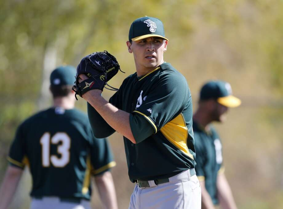 A's pitcher Fernando Rodriguez, (33) during practice at the Papago Baseball Facility in Phoenix, Arizona on Tuesday Feb. 18,  2014. Major League Baseball's Oakland Athletics continue their spring training in the Arizona Desert in preparation for the upcoming season. Photo: The Chronicle