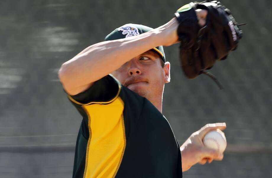 A's pitcher Scott Kazmir, (26) throws during practice at the Papago Baseball Facility in Phoenix, Arizona on Tuesday Feb. 18,  2014. Major League Baseball's Oakland Athletics continue their spring training in the Arizona Desert in preparation for the upcoming season. Photo: The Chronicle