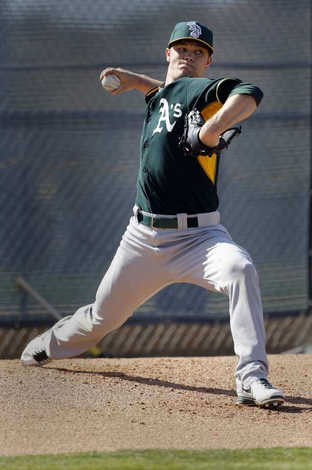 A's pitcher Sonny Gray, (54) throws at the Papago Baseball Facility  at Phoenix Municipal Stadium in Phoenix, Arizona on Tuesday Feb. 18,  2014. Major League Baseball's Oakland Athletics continue their spring training in the Arizona Desert in preparation for the upcoming season. Photo: The Chronicle