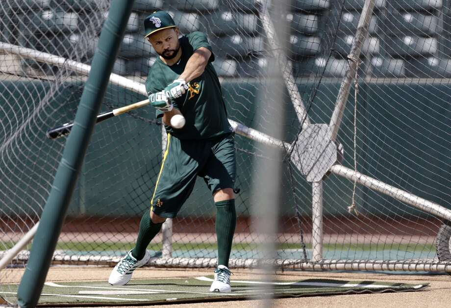 A's Coco Crisp, (40) takes batting practice at Phoenix Municipal Stadium in Phoenix, Arizona on Tuesday Feb. 18,  2014. Major League Baseball's Oakland Athletics continue their spring training in the Arizona Desert in preparation for the upcoming season. Photo: The Chronicle