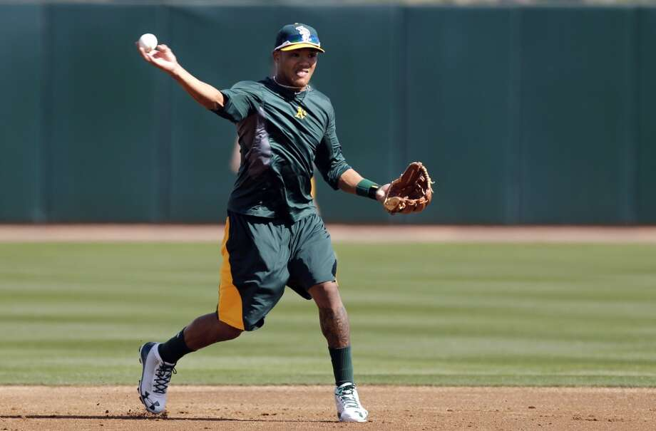 Shortstop Addison Russell, (17) takes grounders during practice at Phoenix Municipal Stadium in Phoenix, Arizona on Tuesday Feb. 18,  2014. Major League Baseball's  Oakland Athletics continue their spring training in the Arizona Desert  to prepare for the upcoming season. Photo: The Chronicle