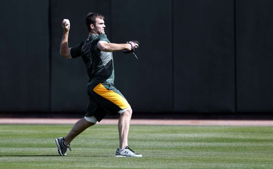 Pitcher Joe Savery, (50) throws a few in the outfield, at Phoenix Municipal Stadium in Phoenix, Arizona on Tuesday Feb. 18,  2014. Major League Baseball's Oakland Athletics continue their spring training in the Arizona Desert in preparation for the upcoming season. Photo: The Chronicle