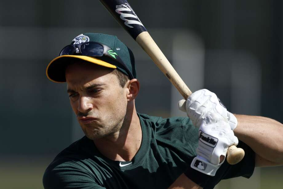 Sam Fuld, (29) prepares for batting practice at Phoenix Municipal Stadium in Phoenix, Arizona on Tuesday Feb. 18,  2014. Major League Baseball's Oakland Athletics continue their spring training in the Arizona Desert in preparation for the upcoming season. Photo: The Chronicle