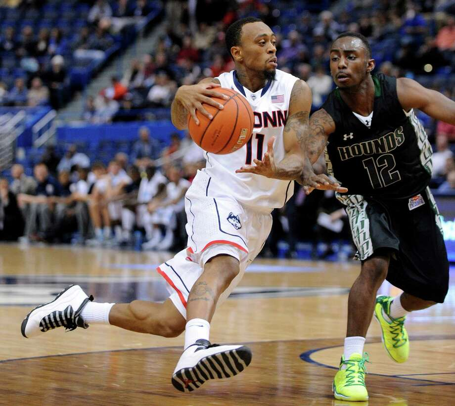 Connecticut guard Ryan Boatright (11) drives past Loyola Maryland guard R.J. Williams (12) during the first half of Connecticut's 76-66 victory over Loyola, Maryland in an NCAA college basketball game, in Hartford, Conn., on Tuesday, Nov. 26, 2013. (AP Photo/Fred Beckham) Photo: Fred Beckham, Associated Press / Associated Press