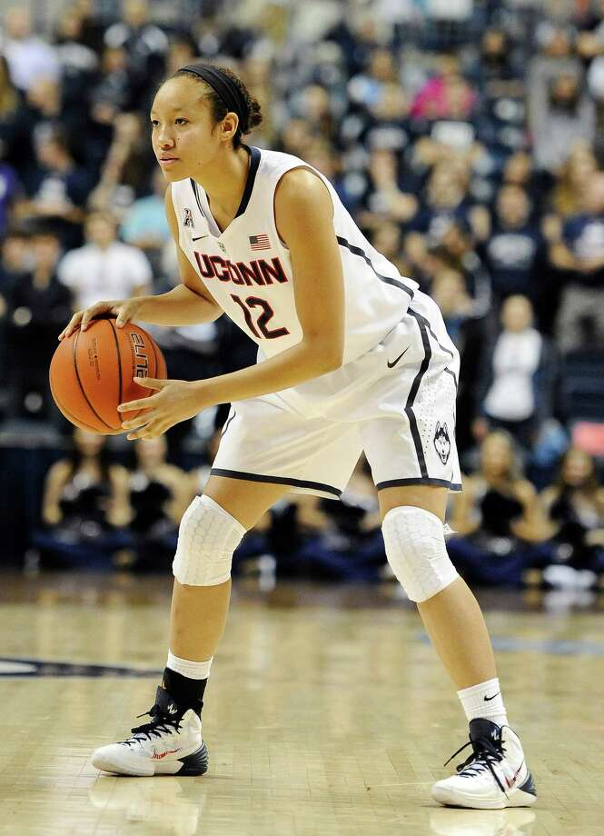 Connecticut's Saniya Chong looks to pass during the second half of an NCAA college basketball game against Cincinnati, Sunday, Dec. 29, 2013, in Storrs, Conn. Connecticut won 67-34. Photo: Jessica Hill, AP / Associated Press