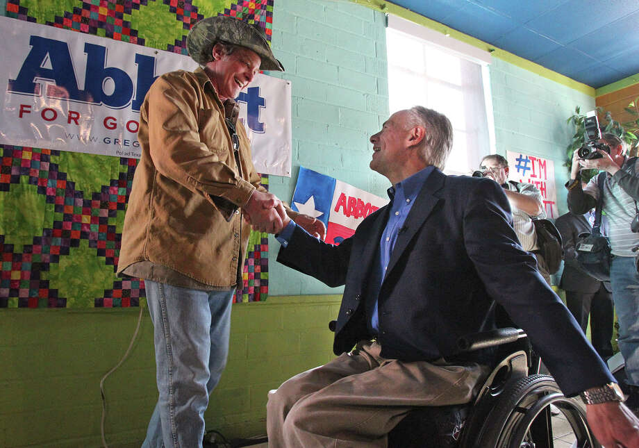 Ted Nugent shakes hands with the candidate as he speaks at a campaign event for Greg Abbott at El Guapo's restaurant in Denton on February 18, 2014. Photo: TOM REEL