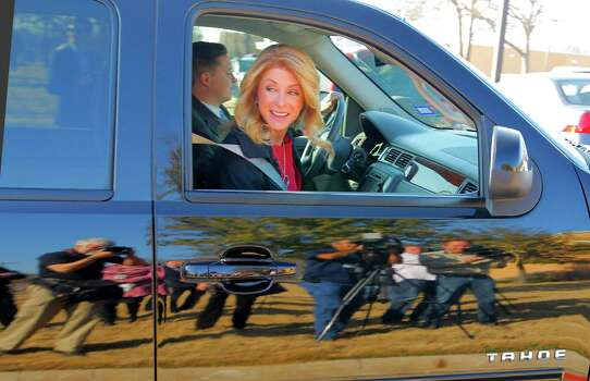 Sen. Wendy Davis arrives to vote on the first day of early voting for the March primary at the Charles Griffin-Sub Courthouse, Tuesday, Feb. 18, 2014, in Fort Worth, Texas. Greg Abbott is the Republican opponent. (AP Photo/Star-Telegram, Rodger Mallison) MAGS OUT; (FORT WORTH WEEKLY, 360 WEST); INTERNET OUT. Photo: Rodger Mallison, Associated Press / Star-Telegram