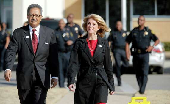 Sen. Wendy Davis, right, walks away after voting with County Commissioner Roy C. Brooks on the first day of early voting for the March primary at the Charles Griffin-Sub Courthouse, Charles Griffin-Sub Courthouse, Tuesday, Feb. 18, 2014, in Fort Worth, Texas. Greg Abbott is the Republican opponent. (AP Photo/Star-Telegram, Rodger Mallison) MAGS OUT; (FORT WORTH WEEKLY, 360 WEST); INTERNET OUT. Photo: Rodger Mallison, Associated Press / Star-Telegram