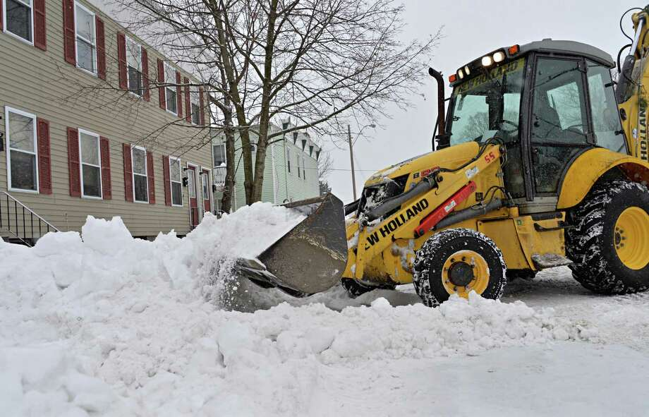 City crews use heavy equipment to clear snow along 110th Street Tuesday Feb. 18, 2014, in Troy, NY.  (John Carl D'Annibale / Times Union) Photo: John Carl D'Annibale / 00025810A