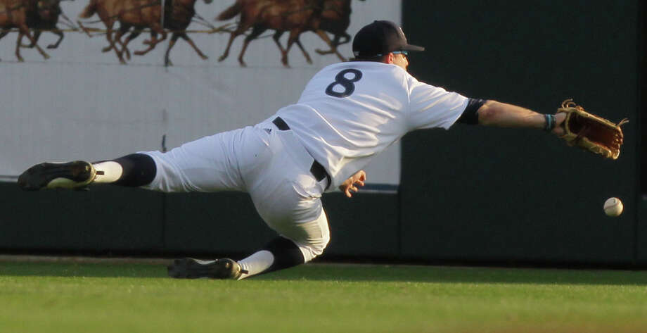 Rice's center fielder John Wiiliamson is unable to catch up to a ball hit by Texas State's David Paiz during the fourth inning of a NCAA baseball game at Reckling Park on Tuesday, Feb. 18, 2014, in Houston. Photo: J. Patric Schneider, For The Chronicle / © 2014 Houston Chronicle
