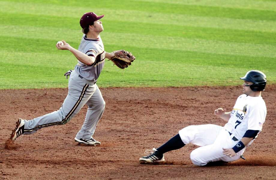Texas State shortstop Garrett Mattlage throws past Rice's John Clay Reeves for a double play during the second inning a NCAA baseball game at Reckling Park on Tuesday, Feb. 18, 2014, in Houston. Photo: J. Patric Schneider, For The Chronicle / © 2014 Houston Chronicle