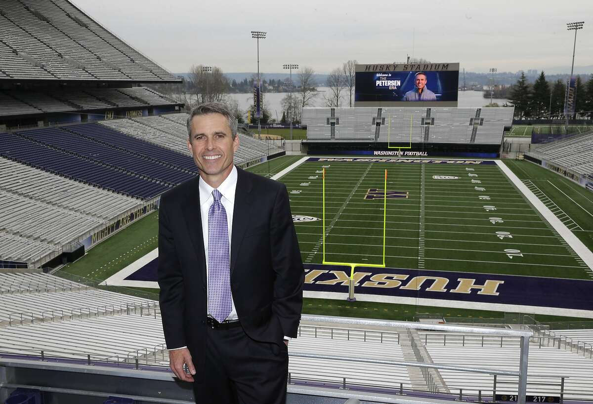New University of Washington head football coach Chris Petersen poses for a photo at Husky Stadium after being officially introduced, Monday, Dec. 9, 2013, in Seattle. Petersen formerly was head coach at Boise State. (AP Photo/Ted S. Warren)