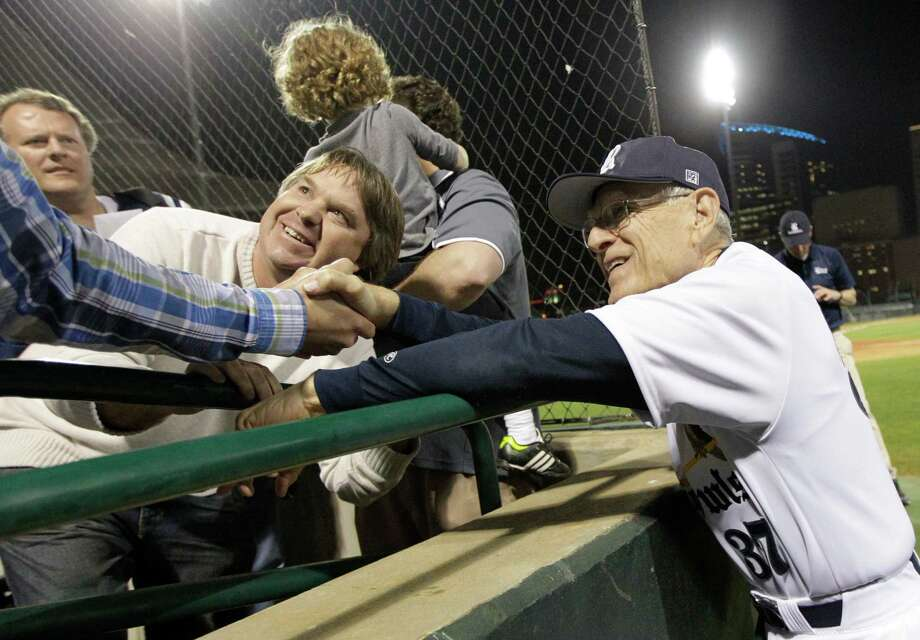 Rice head coach Wayne Graham shakes hands with fans after receiving his 1000th career win during a NCAA baseball game against Texas State at Reckling Park on Tuesday, Feb. 18, 2014, in Houston. Photo: J. Patric Schneider, For The Chronicle / © 2014 Houston Chronicle