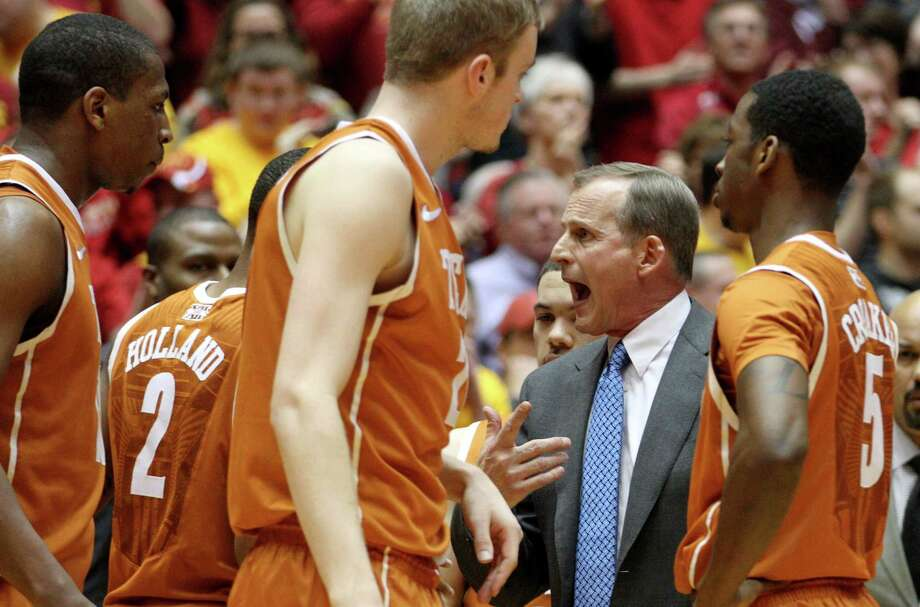 Texas coach Rick Barnes talks toi his players during a timeout in the first half of an NCAA college basketball game against Iowa State at Hilton Coliseum in Ames, Iowa, Tuesday, Feb. 18, 2014. (AP Photo/Justin Hayworth) Photo: Justin Hayworth, Associated Press / FR170760 AP