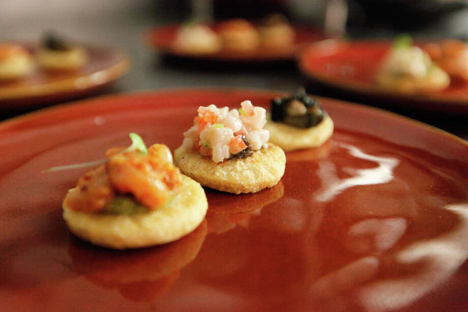 Sopes, featuring smoked oyster, swordfish and scallops, at Mixtli restaurant, 5251 McCullough, on Wednesday, Feb. 12, 2014.  MARVIN PFEIFFER/ mpfeiffer@express-news.net Photo: MARVIN PFEIFFER, Marvin Pfeiffer/ Express-News / Express-News 2014