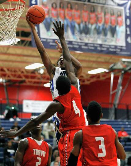 Clear Spring's Je'Coby Bush (10)  drives to the basket on Travis' Hakeem Butler during a high school