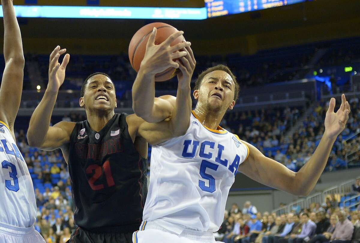 Stanford forward Anthony Brown, left, and UCLA guard Kyle Anderson battle for a rebound during the second half of an NCAA college basketball game, Thursday, Jan. 23, 2014, in Los Angeles. (AP Photo/Mark J. Terrill)