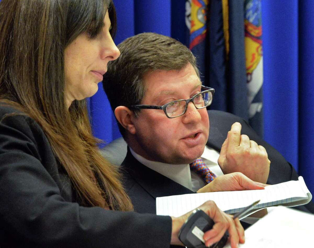 Chairman Daniel J. Horwitz confers with Executive Director Letizia Tagliafierro, left, during a JCOPE state ethics commission meeting Tuesday Feb. 18, 2014, in Albany, NY. (John Carl D'Annibale / Times Union)
