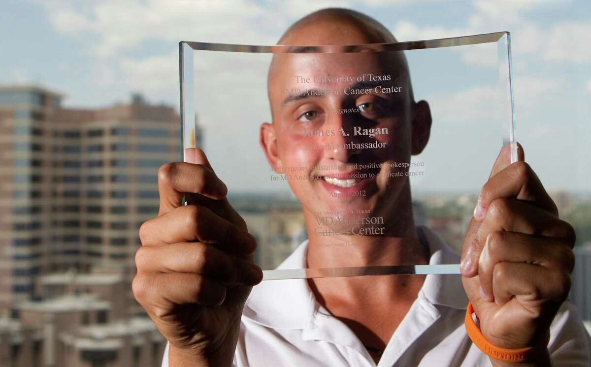 James Ragan holds an etched glass appointing him special ambassador of M.D. Anderson.