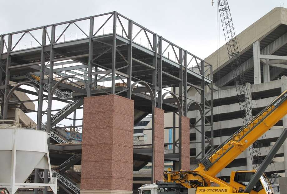 The red brick as part of the new $450 million renovation of Kyle Field is rising skyward on the stadium's northeast end. Most of Texas A&M's campus features beige or tan buildings, but Kyle Field's prevalent red will resemble that of A&M's 2-year-old baseball stadium, Blue Bell Park. Photo: Brent Zwerneman, San Antonio Express-News