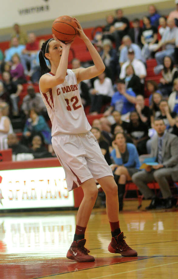 "Cy-Woods 6'9"" sophomore post Nancy Mulkey takes aim on the basket against Katy Taylor during 1st quarter action of their Region III-5A quarterfinal matchup Cy-Lakes High School on Tuesday. Photo: Jerry Baker, For The Chronicle"