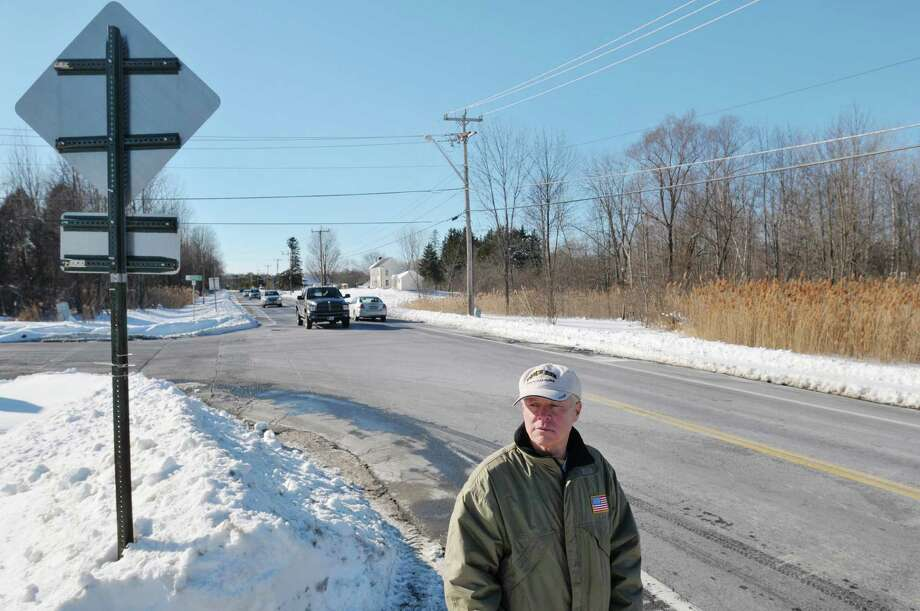 Ellwood Sloat stands along Round Lake Road near the intersection with Chango Drive on Monday, Feb. 17, 2014 in Malta, NY.  Sloat is one of the area residents who is against proposed plans to place a roundabout at this intersection and another one just down the road.  (Paul Buckowski / Times Union) Photo: Paul Buckowski / 00025793A
