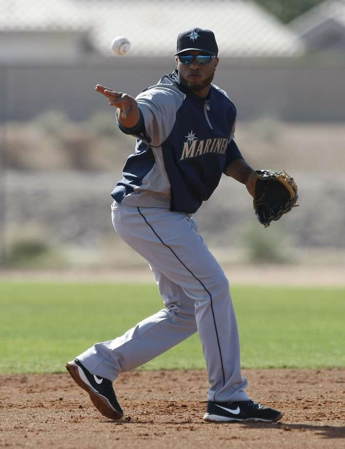 Seattle Mariners second baseman Robinson Cano flips the ball to second base during spring training baseball practice, Tuesday, Feb. 18, 2014, in Peoria, Ariz. (AP Photo/Rick Scuteri) Photo: AP
